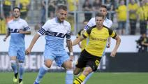 orial	ESSEN, GERMANY - AUGUST 12: Ciro Immobile of SS Lazio compete for the ball with Manuel Akanji of Borussia Dortmund during the Borussia Dortmund v Lazio - Pre-Season Friendly at the Essen Stadium on August 12, 2018 in Essen, Germany. (Photo by Marco Rosi/Getty Image