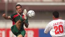 Tunisia's Tahar El Khalej looks at Moustapha Hadji (L) kicking the ball Morocco's Jamal Sellami during their African Nations Cup match Morocco vs Tunisia 29 January 2000 in Lagos. Morocco joined Nigeria at the top of the Group D in the African Nations Cup by drawing 0-0 with Tunisia. (ELECTRONIC IMAGE) AFP PHOTO (Photo by Olivier MORIN / AFP) (Photo credit should read OLIVIER MORIN/AFP via Getty Images)