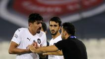 Sadd SC's Spanish coach Xavi Hernandez speaks with Sadd SC's Algerian forward Baghdad Bounedjah (L) during the AFC Champions League round of 16 second leg football match between Qatar's al-Sadd and Qatar's al-Duhail at Jassim bin Hamad stadium in Doha on August 13, 2019. (Photo by KARIM JAAFAR / AFP) (Photo credit should read KARIM JAAFAR/AFP via Getty Images)