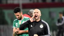 Algeria's player Riyad Mahrez (L) and head coach Djamel Belmadi gesture during the friendly football match between Algeria and DR Congo at Mustapha Tchaker stadium in the city of Blida on October 10, 2019. (Photo by RYAD KRAMDI / AFP) (Photo by RYAD KRAMDI/AFP via Getty Images)