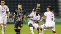 Sadd's midfielder Santi Cazorla (L) passes the ball as he is marked by Ain's midfielder Yahia Nader (R) during the AFC Champions League group D match between UAE's Al-Ain and Qatar's Al-Sadd on September 15, 2020, at the Jassim Bin Hamad Stadium in the Qatari capital of Doha. (Photo by KARIM JAAFAR / AFP) (Photo by KARIM JAAFAR/AFP via Getty Images)