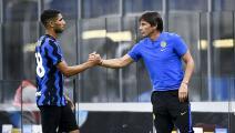 Antonio Conte (R), head coach of FC Internazionale, shakes...