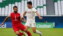 Sadd's forward Baghdad Bounedjah (R) dribbles past Persepolis' defender Hossein Kanaanizadegan (L) during the AFC Champions League Round of 16 match between Iran's Persepolis and Qatar's Al-Sadd on September 27, 2020, at the Education Stadium in the Qatari city of Ar-Rayyan. (Photo by Mustafa ABUMUNES / AFP) (Photo by MUSTAFA ABUMUNES/AFP via Getty Images)