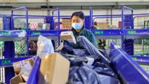 توصيل الطلبات للمنازل في الصين(Getty)