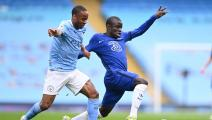 Manchester City's English midfielder Raheem Sterling (L) vies with Chelsea's French midfielder N'Golo Kante (R) during the English Premier League football match between Manchester City and Chelsea at the Etihad Stadium in Manchester, north west England, on May 8, 2021. - RESTRICTED TO EDITORIAL USE. No use with unauthorized audio, video, data, fixture lists, club/league logos or 'live' services. Online in-match use limited to 120 images. An additional 40 images may be used in extra time. No video emulation.