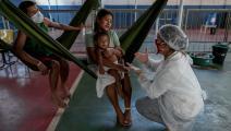 سكان أصليون من فنزويلا وكورونا (مايكل دانتاس/ فرانس برس)