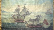 رسمة لمعركة بحرية لسفينة تركية من الجزائر وسفينة فرسان مالطة عام 1719(ويكيبيديا)