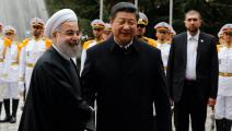 الرئيسان الصيني شي جين بينغ والإيراني حسن روحاني في طهران عام 2016