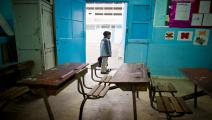 """A boy waits in his school in the center A boy waits in his school in the center of Tunis on January 24, 2011. Many primary schools remained shut on January 24 despite a government order to re-open after teachers called an """"unlimited"""" strike in protest against the national unity government installed after the end of veteran leader Zine El Abidine Ben Ali's 23-year rule. AFP PHOTO / MARTIN BUREAU (Photo credit should read MARTIN BUREAU/AFP via Getty Images)"""