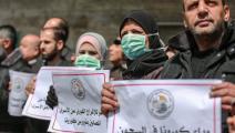 فلسطينيون يطالبون بحماية الأسرى من كورونا (Getty)