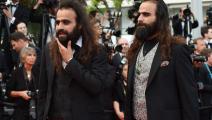 الأخوان طرزان (يمين) وعرب ناصر (آنّ ـ كريستين بوجولات/ فرانس برس/ Getty)