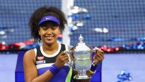 NEW YORK, NEW YORK - SEPTEMBER 12: Naomi Osaka of Japan celebrates with the trophy after winning her Women's Singles final match against Victoria Azarenka of Belarus on Day Thirteen of the 2020 US Open at the USTA Billie Jean King National Tennis Center on September 12, 2020 in the Queens borough of New York City. (Photo by Matthew Stockman/Getty Images)