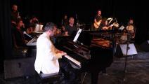 """(""""فرقة رم"""" الأردنية بقيادة الموسيقى طارق الناصر)"""
