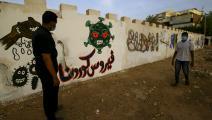 وقاية من كورونا وجدارية توعوية في الخرطوم(أشرف الشاذلي/فرانس برس)