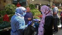 JORDAN-HEALTH-VIRUS-RAMADAN Women buy fresh vegetables at a market ahead of the Muslim holy month of Ramadan, during the novel coronavirus pandemic crisis in the Jordanian capital Amman, on April 23, 2020. (Photo by Khalil MAZRAAWI / AFP) (Photo by KHALIL MAZRAAWI/AFP via Getty Images)