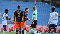 French refere Willy Delajod gives a red card to Montpellier's French defender Damien Le Tallec during the French L1 football match between Montpellier and Reims at the Mosson stadium in Montpellier, southern France, on October 25, 2020. (Photo by Pascal GUYOT / AFP) (Photo by PASCAL GUYOT/AFP via Getty Images)