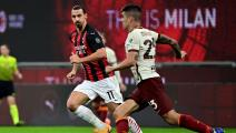 AC Milan's Swedish forward Zlatan Ibrahimovic (L) vies with Roma's Italian defender Gianluca Mancini during the Italian Serie A football match between AC Milan and AS Roma at the Meazza Stadium in Milan on October 26, 2020. (Photo by MIGUEL MEDINA / AFP) (Photo by MIGUEL MEDINA/AFP via Getty Images)