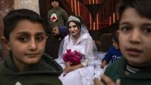 رغم فرحة حفل الزفاف، قد لا ينجح لمّ الشمل (دليل سليمان/ فرانس برس)