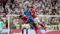 Ahly's midfielder Amr el-Solia (L) and defender Yasser Ibrahim (R) vie for a header against Zamalek's forward Mostafa Mohamed (C) during the Egyptian Super Cup final football match between Ahly SC and Zamalek SC at Mohammed Bin Zayed stadium in Abu Dhabi on February 20, 2020. (Photo by Mahmoud KHALED / AFP) (Photo by MAHMOUD KHALED/AFP via Getty Images)