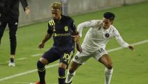 FORT LAUDERDALE, FLORIDA - SEPTEMBER 06: Hany Mukhtar #10 of Nashville SC and Victor Ulloa #13 of Inter Miami CF battle for control of the ball at Inter Miami CF Stadium on September 06, 2020 in Fort Lauderdale, Florida. (Photo by Michael Reaves/Getty Images)