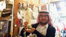 DOHA, QATAR - JANUARY 03: A merchant holds up a plastic copy of the FIFA World Cup at Souq Waqif during the FC Bayern Muenchen training camp on January 3, 2018 in Doha, Qatar. (Photo by Alex Grimm/Bongarts/Getty Images)