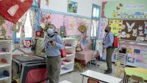 (من إجراءات الوقاية من كورونا في مدرسة تونسية، Getty)