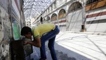 في السوق القديم بمدينة حمص (لؤي بشارة/  فرانس برس)