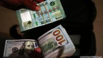 الليرة اللبنانية مقابل الدولار (حسين بيضون/العربي الجديد)