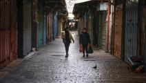 أحد أسواق القدس القديمة في زمن الإقفال (فرانس برس)