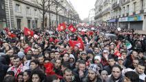 """التوانسة في 15 يناير 2011: """"بن علي هرب"""" (فرنسوا غيّيو/ فرانس برس/ Getty)"""