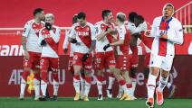 """Monaco's Montenegro forward Stevan Jovetic (C) celebrates with teammates after scoring a goal during the French L1 football match Monaco and Marseille at """"Louis II"""" stadium in Monaco, on January 23, 2021. (Photo by Valery HACHE / AFP) (Photo by VALERY HACHE/AFP via Getty Images)"""