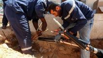 تمديدات كهرباء في ليبيا (محمود تركية/ فرانس برس)