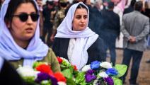 أيزيديتان قرب سنجار بتكريم لضحايا قتلهم داعش- فرانس برس
