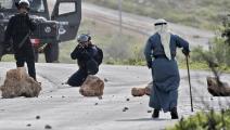 مسن فلسطيني يواجه جنود الاحتلال- فرانس برس