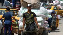 أسواق العراق عمال العراق (فرانس برس)