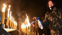 إضاءة شموع في ذكرى كارثة تشيرنوبيل (جينيا سافيلوف/ فرانس برس)