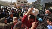 تزاحم على شراء الماء والخبز في العاصمة عمان