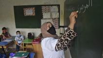 معلمة وتلاميذ في الجزائر (رياض كرامدي/ فرانس برس)