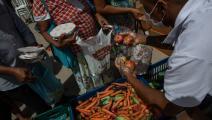 مساعدات غذائية وسط كورونا في البرازيل (ألكسندر شنايدر/ Getty)