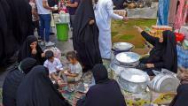 رواد الأسواق الشعبية بلا وقاية في العراق (علي نجفي/ فرانس برس)