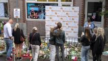 ورود في مكان استهداف الصحافي بيتر دي فريس في أمستردام (إيفيرت إلزينغا/فرانس برس)