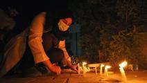 شموع لضحايا مستشفى الناصرية بالعراق (أسعد نيازي/ فرانس برس)