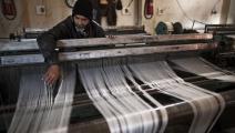 مصنع خيوط القطن في إدلب (جيم لوبيز/ فرانس برس)