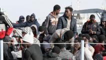 نُقل المهاجرون إلى العاصمة الليبية طرابلس (محمود تركية/ فرانس برس)