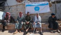 سوريون ينتظرون لقاح كورونا في إدلب (عمر حاج قدور/ فرانس برس)