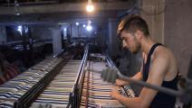 ورشة منسوجات في مدينة حلب (فرانس برس)