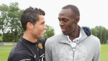 MANCHESTER, ENGLAND - MAY 15: *** EXCLUSIVE ACCESS *** (MINIMUM USAGE FEE APPLIES - 250 GBP OR LOCAL EQUIVALENT) Cristiano Ronaldo of Manchester United meets Olympic Champion Usain Bolt ahead of a First Team training session at Carrington Training Ground on May 15 2009, in Manchester, England. (Photo by Matthew Peters/Manchester United via Getty Images)