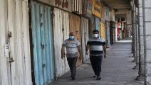 أعباء كبيرة يتكبدها العراقيون بفعل كورونا والفساد (فرانس برس)