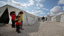 توعية لمنع تفشي كورونا بالشمال السوري (عمر قدور/فرانس برس)