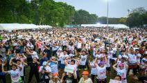 """مسيرة """"ركض ضد الديكتاتورية"""" في بانكوك (ميلادن أنتونوف/فرانس برس)"""